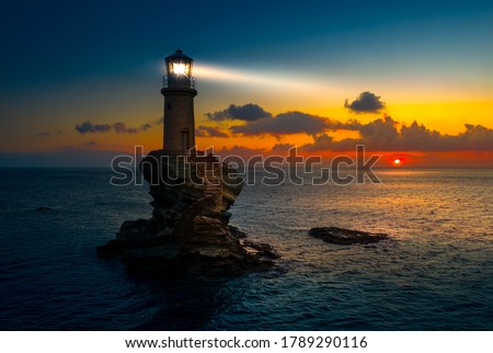 The beautiful Lighthouse Tourlitis of Chora in Andros island, Cyclades, Greece Royalty-Free Stock Photo #1789290116