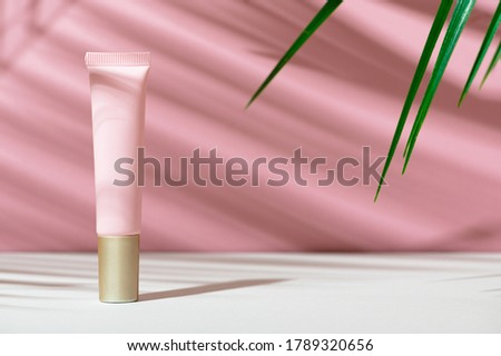 Eco-friendly tube with face cream. Women's care cosmetics with natural composition. Feminine hygiene product for facial skin care. Skincare, organic balm, soft lotion. Copy space, mockup Royalty-Free Stock Photo #1789320656