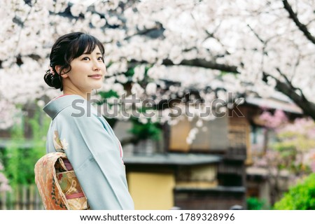 Young asian woman wearing kimono. Japanese traditional clothes. Royalty-Free Stock Photo #1789328996