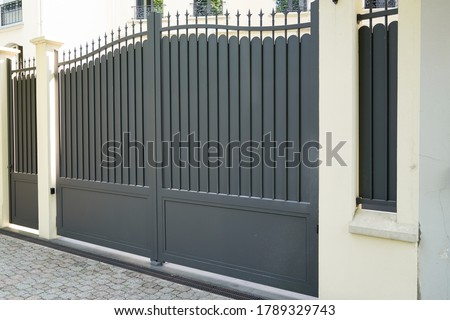 steel grey gate aluminum portal of suburb home Royalty-Free Stock Photo #1789329743