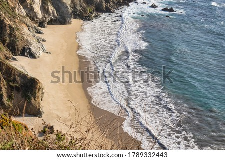 Big Sur, United States - February 18 2020 : the picture shows an impressive panorama of the wild coast line at Big Sur and a beach