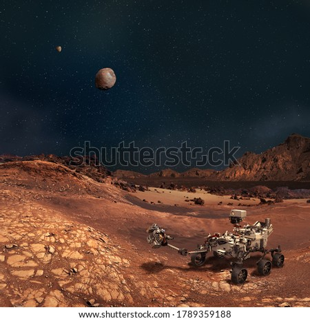 Perseverance rover in the Planet Mars rocky landscape. Moons Phobos and Deimos on the sky. Some elements furnished by NASA. Royalty-Free Stock Photo #1789359188