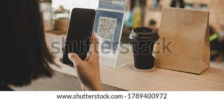 Panoramic banner. customer using digital mobile phone scan QR code pay for buying coffee in cafe coffee shop, restaurant, digital payment, online shopping, takeaway food, internet technology concept Royalty-Free Stock Photo #1789400972