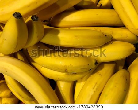 Macro photo food product yellow bananas. Stock photo Texture background tropical ripe fruit bananas. Natural useful banana peel. #1789428350