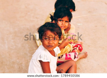 Little girls are looking. Playing with imagination. Like they are in a boat in the middle of a sea on a heavy rainy night with thunderstorm. Nostalgia. Copyspace. Colorful clothes. Happy,cheerful fun.