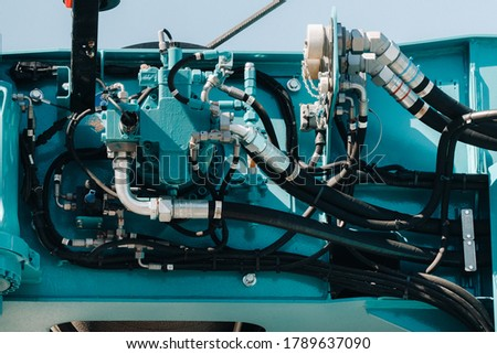 Hydrostatic crane engine.The control system of the crane engine.Lifting hydraulic Department on the truck crane.The hydraulic system of the engine.hydraulic hoses on the crane.autoparts Royalty-Free Stock Photo #1789637090