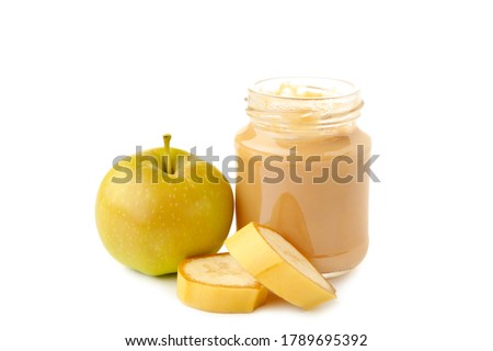Jar of baby puree with apple and banana isolated on white. Top view Royalty-Free Stock Photo #1789695392