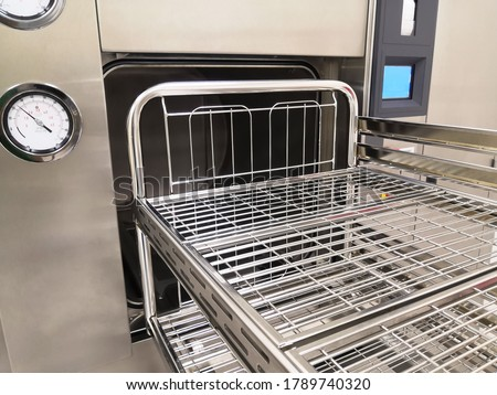 Closeup Image Of Steam Sterilization Machine And Trolley Royalty-Free Stock Photo #1789740320