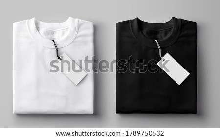 Black and white folded t-shirt with label. Royalty-Free Stock Photo #1789750532