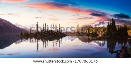 Panoramic View of Garibaldi Lake during a colorful morning sunrise. Cloudy Sky Composite. Panoramic Canadian Mountain Landscape. Located near Vancouver, BC, Canada. Nature Background Panorama Royalty-Free Stock Photo #1789863176