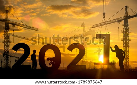 Silhouette construction site,Cranes building construction 2021 year sign #1789875647