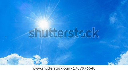 Scene of beautiful afternoon sun and natural flare ray light, nice blue sky and white clouds in rainy season with copy space. Nature landscape template and weather forecast background.