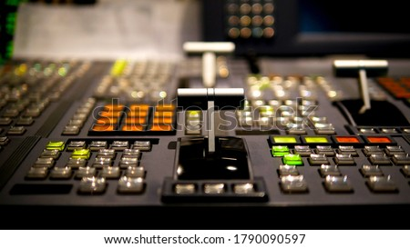 Blur image video switch of Television Broadcast, working with video and audio mixer, control broadcasts in recording studio. Broadcasting in the studio, professional mixing sender color buttons. Royalty-Free Stock Photo #1790090597