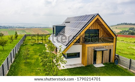 Eco house with sun panels energy Royalty-Free Stock Photo #1790214701