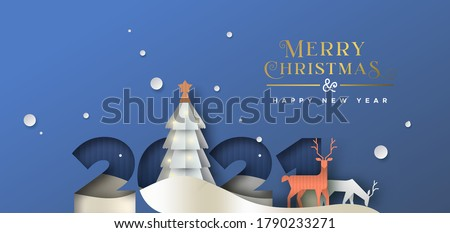 Merry Christmas Happy new year greeting card illustration. 2021 papercut number with winter forest landscape. 3D paper cut craft rein deer and pine tree scene for party invitation or holiday wishes. #1790233271