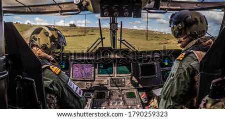 Military Helicopter Merlin EH101 cockpit on a training mission. Royalty-Free Stock Photo #1790259323