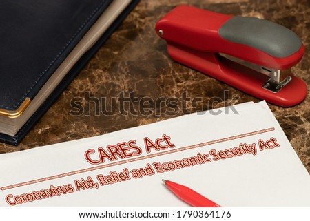 Coronavirus Aid, relief, economic security, CARES ACT text is written on a white paper against a marble table background. Royalty-Free Stock Photo #1790364176