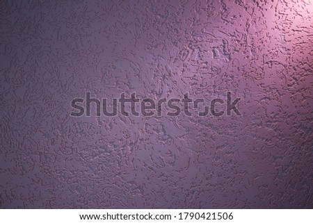Pink light on dark lilac structural background with patterns #1790421506