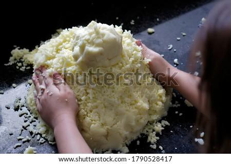 A child shaping the potato dough. #1790528417