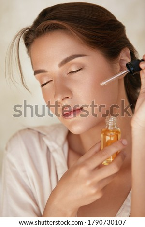 Skin Care. Woman Applying Essential Oil With Dropper On Face. Natural Cosmetic Product For Hydrated, Glowing And Healthy Facial Derma. Portrait Of Beauty Model With Perfect Skin. Royalty-Free Stock Photo #1790730107