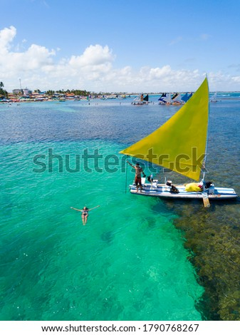 Young couple swimming in the natural pools in Porto de Galinhas Pernambuco - Brazil Royalty-Free Stock Photo #1790768267