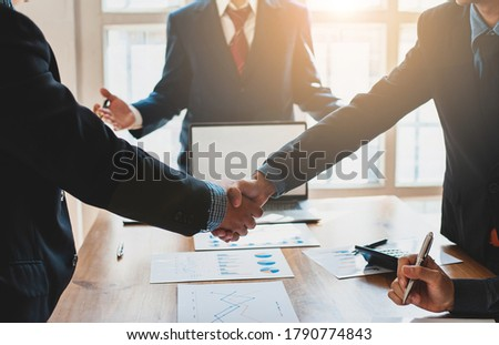 Business people shake hands with business partners at a meeting. The concept of organizational dispute settlement. Royalty-Free Stock Photo #1790774843