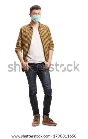 Full length portrait of a young casual man with a protective face mask isolated on white background Royalty-Free Stock Photo #1790811650