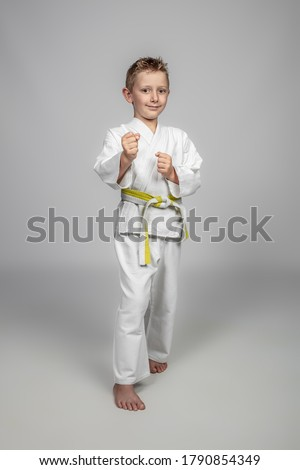 martial arts, a child with judogi in a guard position. Royalty-Free Stock Photo #1790854349