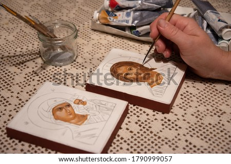 Hand painted orthodox icon during painting on piece of wood. A pair of wedding icons. Mother of God of Tenderness and Christ the Pantocrator