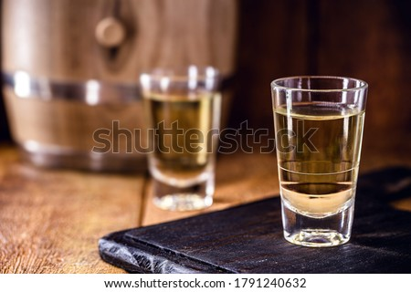 """Brazilian drink known as Cachaça, """"pinga"""", cane or distilled sugar cane. Name given to cognac produced in Brazil. It is used in the preparation of the caipirinha known worldwide. #1791240632"""