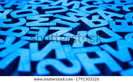 background of different wooden letters. letters background. back to school idea.