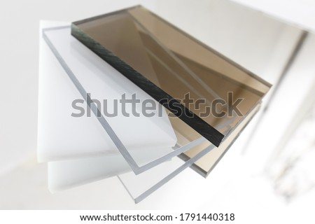 Solid Polycarbonate Sheet. Brown, white, transparent. Acrylic Plastic glass Royalty-Free Stock Photo #1791440318