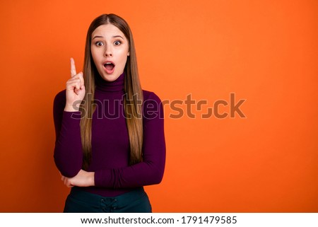 Photo of astonished woman think thoughts get great idea raise index finger up impressed scream wear good look jumper isolated over bright color background