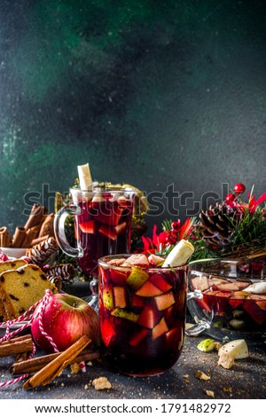 Festive winter fruit punch or sangria drink. Christmas mulled red wine. Ponche de frutas Navideño cocktail, Mexian Christmas hot  beverage with sugar cane and fruit, hot sweet liquor wine drink Royalty-Free Stock Photo #1791482972