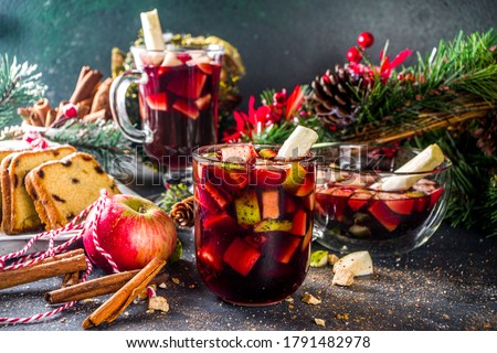 Festive winter fruit punch or sangria drink. Christmas mulled red wine. Ponche de frutas Navideño cocktail, Mexian Christmas hot  beverage with sugar cane and fruit, hot sweet liquor wine drink Royalty-Free Stock Photo #1791482978