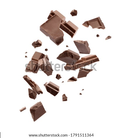 Milk chocolate pieces falling on white background Royalty-Free Stock Photo #1791511364