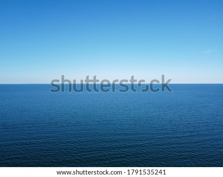 Blue horizon where the cloudless sky and the blue sea converge. Royalty-Free Stock Photo #1791535241