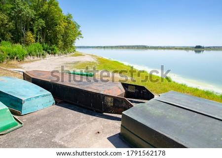 Boats on the shore of Étang de Lindre in Parc Naturel Régional de Lorraine, France #1791562178