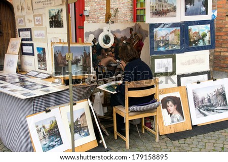 BRUGES, BELGIUM - JUNE 18: Fine art painter H. Socotti in Bruges, Belgium on June 18, 2013.  #179158895