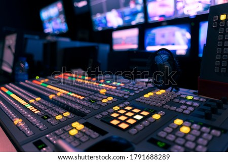 video switch of Television Broadcast, working with video and audio mixer, control broadcasts in recording studio. Royalty-Free Stock Photo #1791688289