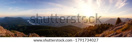 Beautiful Panoramic View of Canadian Nature Landscape from the top of Tin Hat Mountain during a sunny summer sunset. Taken near Powell River, Sunshine Coast, British Columbia, Canada. Royalty-Free Stock Photo #1791734027