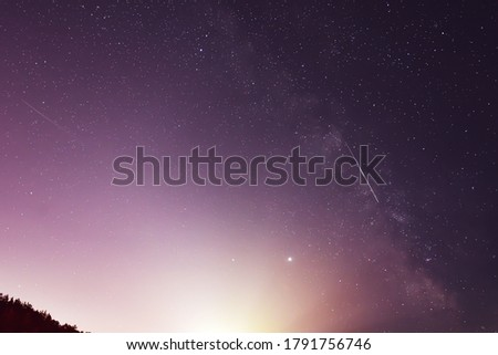 Milky Way, Jupiter and Saturn Planets  and the shooting stars of the Perseid meteor shower in the night.