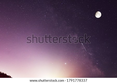 Moon, Milky Way, Jupiter and Saturn Planets  and the shooting stars of the Perseid meteor shower in the night.