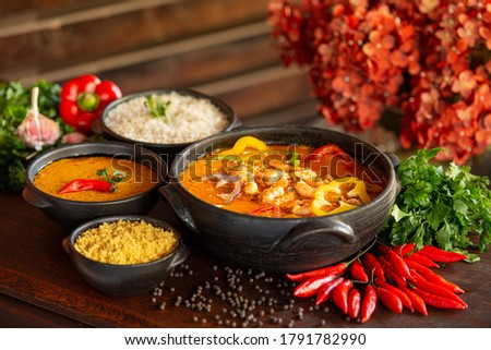 Shrimp stew, usually served with rice, mush and manioc flour. Traditional dish of Brazilian cuisine and consumed throughout the Brazilian coast. Royalty-Free Stock Photo #1791782990
