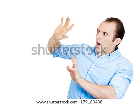 Closeup portrait of young man looking shocked scared trying to protect himself from unpleasant situation or object thrown at him, isolated white background. Negative emotion facial expression feeling #179180438