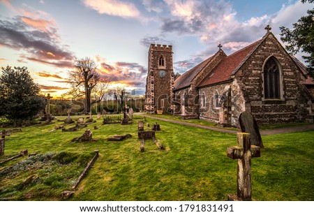 Rural old cemetery church in evening. Cemetery church in rural sunset. Sunset cemetery church. Old cemetery church scene #1791831491