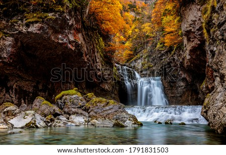Autumn mountain waterfall stream view. Waterfall in autumn mountains. Autumn waterfall in mountains. Autumn mountain waterfall landscape #1791831503
