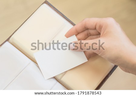 business card holder, visiting cards. Business card in the hands of, Business finance and education concept.