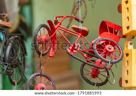 This image is of a red toy of cycle rickshaw made of wood and iron from a local toyshop in Ajmer. Royalty-Free Stock Photo #1791881993