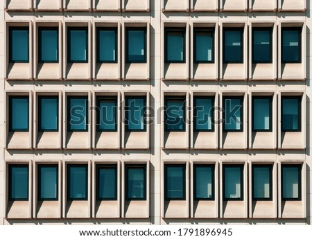 Building exterior with geometric rows of windows.